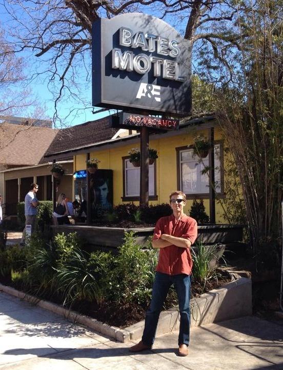 Phillip Atteberry, landscape designer of A&E Bates Motel SXSW, standing in front of hotel